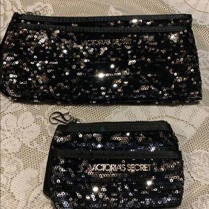 Two Victoria's Secret black & silver bags.